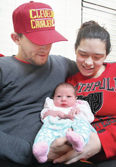 """Paula Ludwig, left, and Michael Payne, both of Sidney, hold their new born baby Alivia Lenora-Skye Payne at the Copeland-Emerson Family Birth Center at Wilson Health Monday, Jan. 1. Alivia was the first baby born in Shelby County in 2018 at 12:22 a.m.. Alivia was born 7 lbs. 5 oz. To celebrate the birth of the first baby of 2018, the hospital presented the baby with gifts including a handmade afghan crocheted by one of Wilson's volunteers, plush stuffed animal, a baby bib, booties, a hat made by Molly Watkins with """"Off the Hook,"""" hand and body lotion, soap and lip balm for mom, slippers, a HALO Sleep Sack and a Bravado! Essential Camisole from the Wilson Health Sweet Beginnings Lactation Boutique. In addition, Picture Perfect Studios has donated a $75 gift card to go towards a Milestone Club package. Other baby's born at Wilson Health can be seen at www.wilsonhealth.org."""