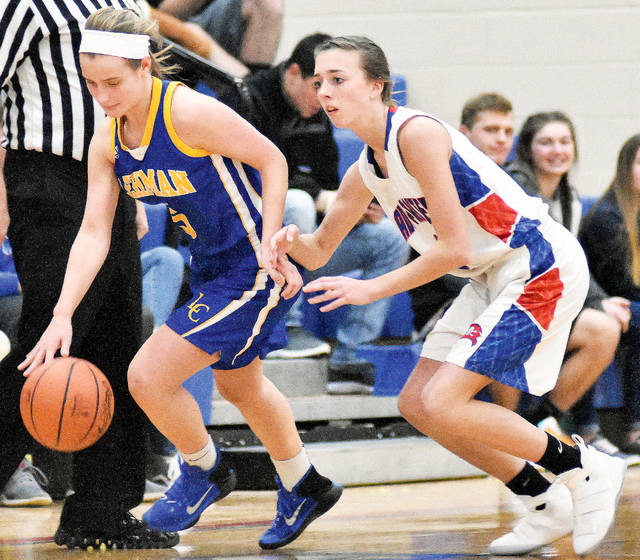 Lehman's Rylie McIver, left, makes her way down the court followed by Riverside's Lauryn Sanford at Riverside on Thursday.