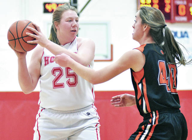 Houston's Jess Monnier, left, looks to get past Jackson Center's Olivia Clark at Houston last Saturday. Monnier scored a season-high 22 points on Saturday against Bradford.