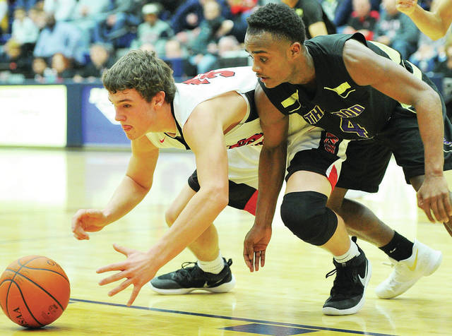 Fort Loramie's Nathan Raterman, left, and Thurgood Marshall's Tavell Sims go after a loose ball during Flyin' to the Hoop at Trent Arena in Kettering last Monday. The Redskins are ranked No. 1 in Div. IV.