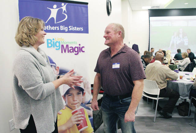 Big Brothers Big Sisters of Shelby and Darke County Executive Director Jennifer Bruns, left, talks with Sidney Body Carstar owner Tom Martin, of Sidney, during the Big Brothers Big Sisters of Shelby and Darke County Volunteer Appreciation Dinner Thursday, Jan. 18. The dinner was held at the Amos Memorial Library. Martin was given the Friends of Big Brothers Big Sisters award during the appreciation lunch. Big Brothers Big Sisters matches volunteers up kids who need good role models to emulate.