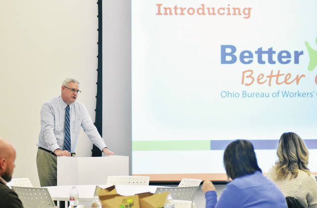 Ohio Bureau of Workers' Compensation Regional Business Consultant Troy Boughan, of Lima, talks about a new workplace health and wellness program. Boughan gave his talk at the Amos Memorial Public Library Tuesday, Jan. 23.