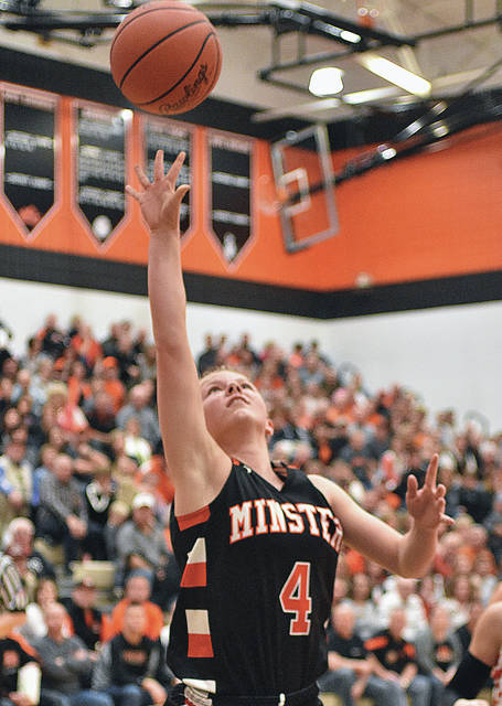 Minster's Ivy Wolf shoots during a Midwest Athletic Conference game on Thursday at Versailles.