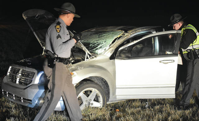 Ohio State Patrol Troopers investigate a one-vehicle rollover, shortly after 9 p.m. Thursday, Jan. 25, that occurred at mile-marker 102 in the southbound lane of Interstate 75 just south of the state Route 274 overpass. The driver was cited with failure to control after a tire on the northbound vehicle blew, causing it to rollover multiple times before coming to a stop in the left lane of I-75 south. Two occupants were transported by Sidney Medics to Wilson Health with minor injuries.