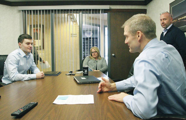 Tyler Lachey, far left, 17, of Sidney, listens as Rep. Jim Jordan, third from left, talks to him about West Point where Lachey will be attending thanks in part to a referral from Jordan. Watching are Lachey's parent's Shannon, second from left and Joe Lachey, both of Sidney. Jordan stopped by Area Electric Friday, Jan. 26, to congratulate Lachey on getting into the West Point.