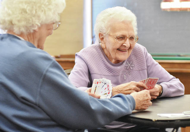 Margaret Helmlinger, left, and Marian Price, both of Sidney, play a game of pinochle at the Senior Center of Sidney-Shelby County Wednesday, Jan. 31. A variety of card games were being played depending on what people felt like playing.