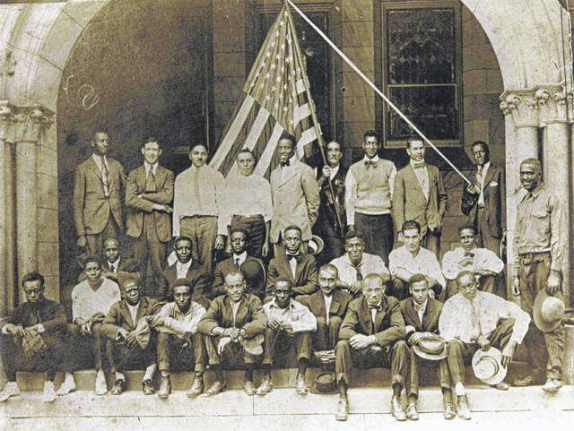 World War I military inductees await transport in Piqua in 1918. Piqua's African-American history will be related during two bus tours planned by the Piqua Public Library for Feb. 24.