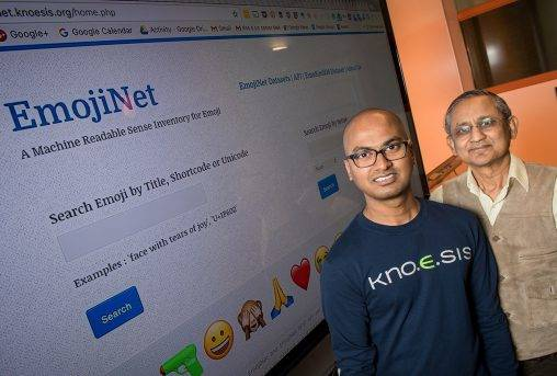 Sanjaya Wijeratne, left, a Ph.D. student in computer science, and Amit Sheth, executive director of Wright State's Ohio Center of Excellence in Knowledge-Enabled Computing, or Kno.e.sis, EmojiNet, a database of emojis.