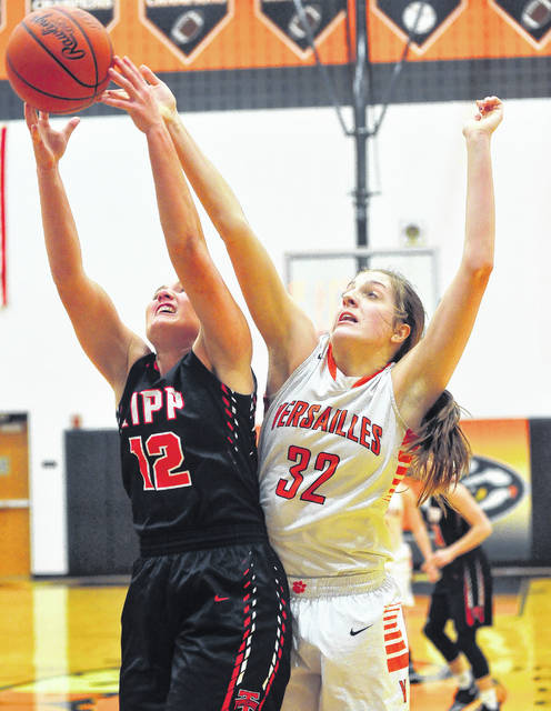 Versailles' Danielle Winner, right, fights for a rebound with Tippecanoe's Brooke Aselage during a nonconference game on Jan. 6.