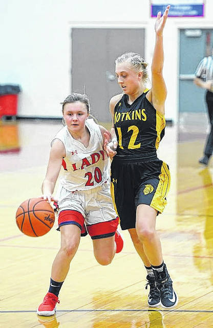 Perry's Lily Floyd dribbles against Botkins' Taira Greve during Mondays' nonconference game at Leonard V. Volbert Gymnasium.