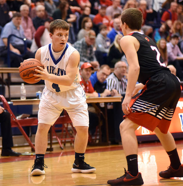 Fairlawn junior guard Lane Greiwe looks to pass with pressure from Triad s  Austin Bails during a Division IV sectional quarterfinal on Friday at  Piqua s ... b1a786395