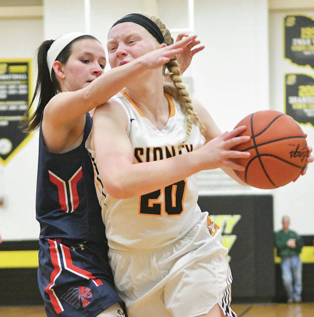 Sidney sophomore guard Carly Dean drives with pressure from Piqua's Elizabeth Kidwell during a Greater Western Ohio Confernece game on Saturday.