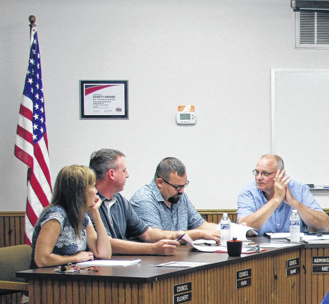 Village administrator Bruce Metz, right, discusses future plans for a tour of Jackson Center's new solar field and waste-water treatment building with Jesse Fark, center, left, and council members Leisha Elchert and James DeVine.