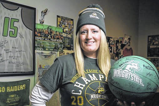 Kristie McKiernan, Wright State grad and senior English lecturer, is a superfan of the Raiders, missing only three home games and attending road contests as far away as Chicago over the past eight years.