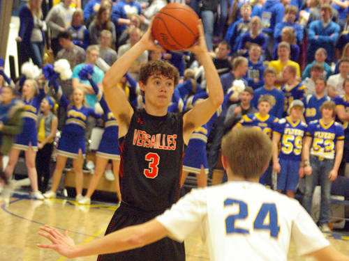 Versailles' Kyle Jones surveys the Marion Local defense during a Midwest Athletic Conference game on Monday in Maria Stein.   Kyle Shaner | AIM Media Midwest