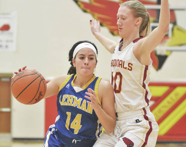 Lehman Catholic senior point guard Alanna O'Leary dribble past New Bremen's Paige Jones during a nonconference game on Dec. 30. O'Leary started her first game in nearly three weeks on Thursday at Anna.