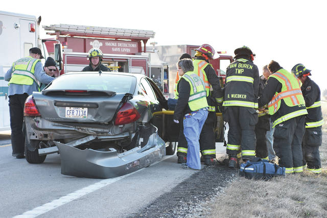 Van Buren Township Firefighters remove an injured passenger around 4:45 p.m. from a car that was rear-ended by another car driven by Ashley Marie Heitbrink, 27, 146 S. Lincoln St., Minster, while it was preparing to turn from state route 119 onto White Feather Road, Wednesday, Jan. 31. The injured passenger, Lucy Arnett, 66, and driver, Robert L. Arnett, 65, both of 13360 White Feather Trail, Anna, were transported by Anna Rescue to Wilson Health. Heitbrink was cited with assured clear distance ahead following the crash.