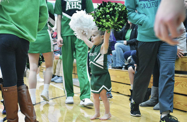 "Lenynn Billing, 3, of Anna, daughter of Jess and Jessica Billing, shows her support for the Anna Rockets during their game against Fort Loramie in Fort Loramie Saturday, Feb. 10. Lenynn's cheerleading outfit was a Christmas gift that replaced her old hand-me-down cheerleading outfit that she used to wear. According to Lenynn's mom her daughter ""Loves cheerleading. It's what she does all day long everyday."" Lenynn's sister Jayce Billing is an Anna Junior High School cheerleader and her brother Hayden Billing is on the Anna High School junior varsity basketball team."
