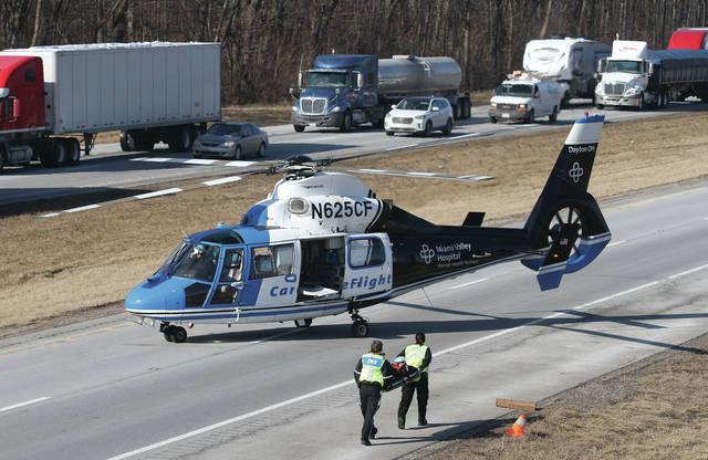CareFlight medics return to their helicopter without any patient after being called to a three-vehicle crash in the northbound lane of I-75 near mile-marker 101 between Anna and Botkins. One person died in the accident. Anna Rescue and Botkins Fire and the Ohio State Patrol responded to the scene. Traffic was blocked in the northbound lanes while southbound traffic was moving slowly. The crash occurred shortly before 2 p.m.