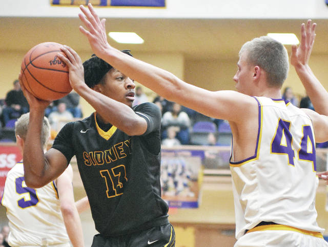 Sidney's Ratez Roberts looks to get the ball past Vandalia-Butler's Sutton Skapik during a Greater Western Ohio Conference game on Tuesday at Butler's Student Activities Center. Sidney won 36-34.