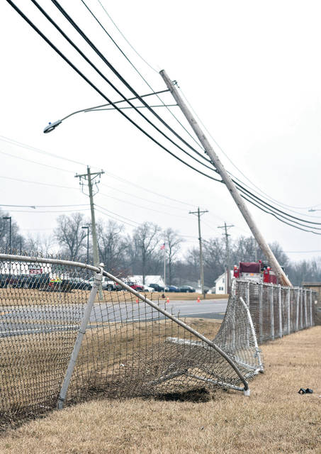 A car struck a utility pole and then a fence that it finally came to rest on just south of Fort Loramie on state route 66. The driver was headed north bound on state route 66 at the time of the crash. The accident was reported Wednesday, Feb. 14 at 12:13 p.m.. The man ran from the scene. He was arrested just north of Fort Loramie.