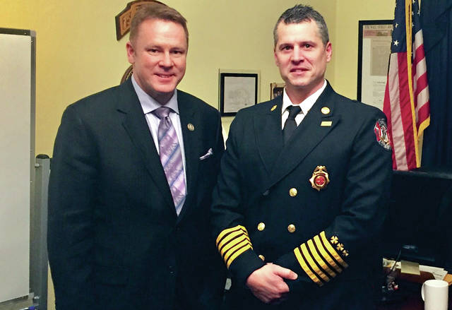 Provided photo Rep. Warren Davidson and Troy Fire Chief Matt Simmons at the State of the Union.