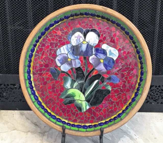 """""""Pansies"""" by Maynard Francis, of Sidney, is on display in an exhibit of Francis's stained glass works in the Gateway Arts Council gallery in Sidney."""