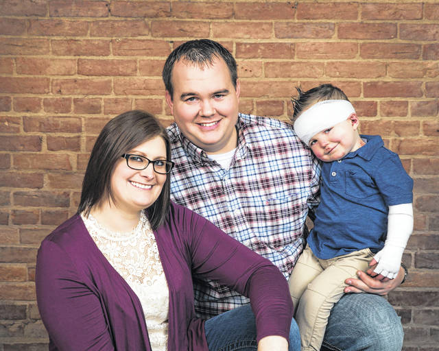 Lindsay and Alex Monnier, along with son, Eli, 2, of Minster, are taking each day as it comes when dealing with Eli's EB diagnosis.