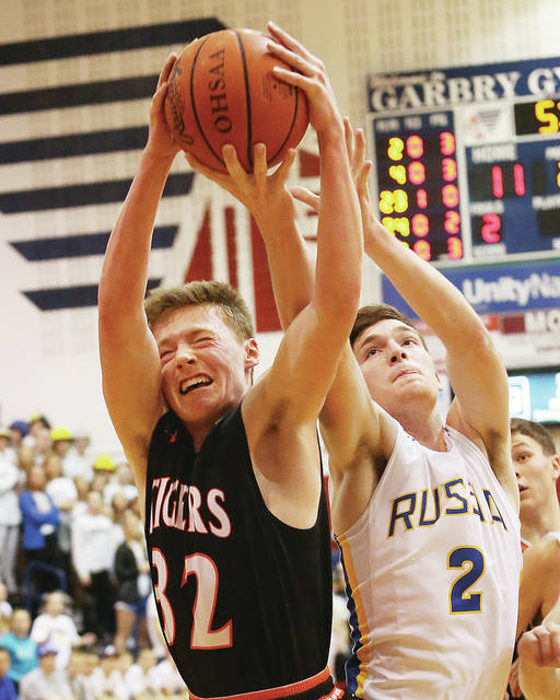 Jackson Center's Aidan Reichert, left, and Russia's Jordan York reach for the ball during a sectional final at Piqua last Friday. Russia will be playing in a district final for the first time in three years.