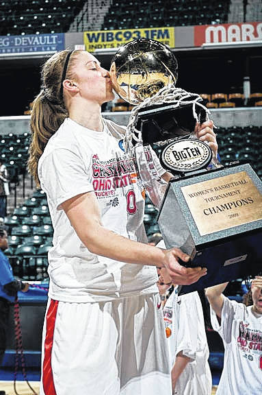 Sarah Schulze Kisses The Team Trophy After Helping Ohio State University Womens Basketball Win Big Ten Championship In 2009