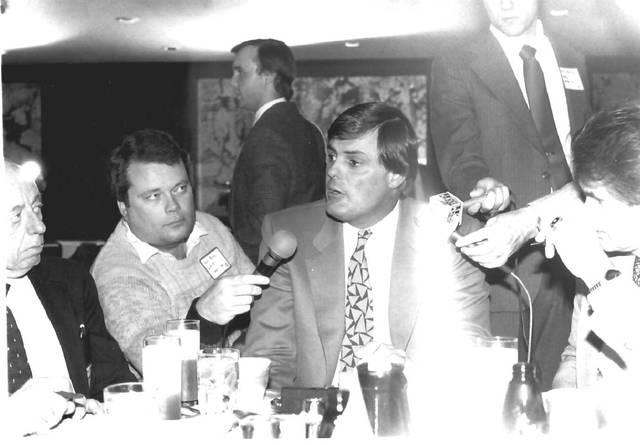 Dave Ross, center left, interviews former Cincinnati Reds manager Lou Piniella during a press conference in 1990. Ross caught up with Piniella recently in Arizona.