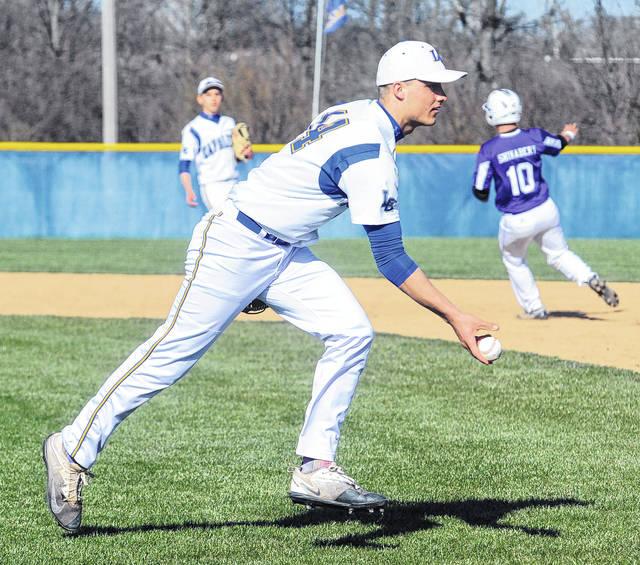 Lehman Catholic pitcher Drew Barhorst fields a bunt and gets an out at first base during a nonconference game in Sidney on Friday.
