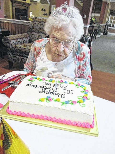 Melba Bender, of New Bremen, blows out the candle on her birthday cake, Thursday, April 11, in the Elmwood Assisted Living in New Bremen. She turned 101.