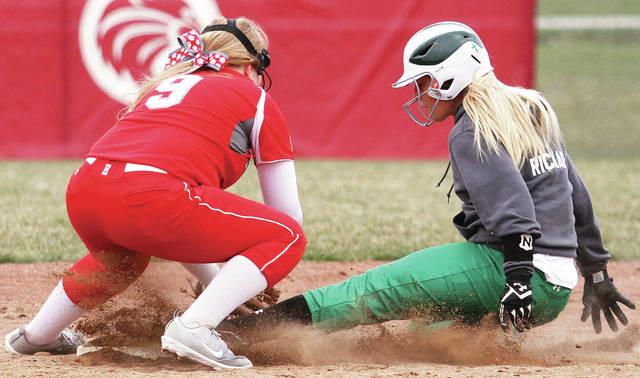 Anna's Macey Richard slides safely into second as Houston's Allisen Foster attempts a tag at Houston Tuesday.