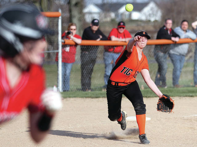 Jackson Center's Connor Pipke throws to first during a Shelby County Athletic League softball game in Jackson Center on Thursday. Fort Loramie beat the Tigers 17-0.