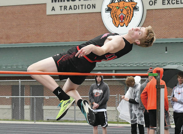 Fort Loramie's Gavin Schulze clears 5-6 in the high jump on Saturday morning at the Minster Memorial track meet.