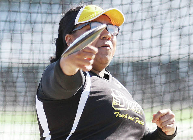 Sidney's Ayla Shropshire throws a discus during the Salzam Relays on Friday in Greenville.