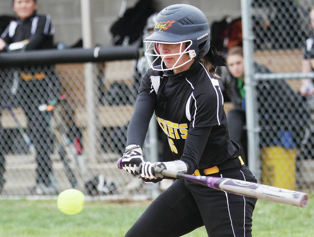 Sidney's Morgan Carey swings during the Yellow Jacket Invite on Saturday at Sidney.