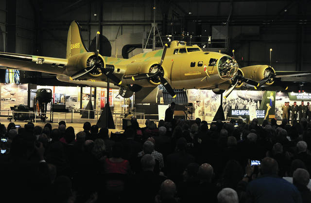 Mike Ullery | AIM Media Midwest B-17 Flying Fortress <em>Memphis Belle</em> is unveiled in a private reception ceremony at the National Museum of the United States Air Force on Wednesday evening. The <em>Belle</em> underwent more than 10 years of restoration work to make her ready for her last mission - to keep the memory of our World War II Army Air Corps veterans alive forever and to educate future generations about the sacrifices and heroism made by our Greatest Generation.