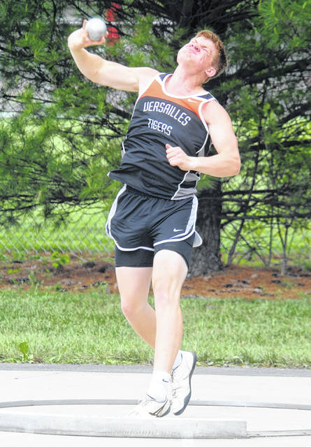 Versailles' A.J. Ahrens throws the shot put during the Division II district final meet on Saturday at Alexander Stadium in Piqua.