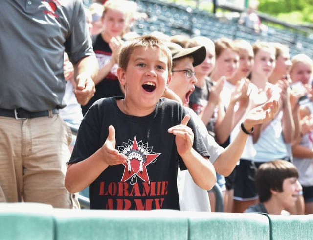Drew Bergman, 8, of Fort Loramie, son of Craig and Abby Bergman, cheers on the Fort Loramie Redskins as they defeat the Trinity Trojans during a Division IV state semifinal game, Thursday, May 31, at Huntington Park in Columbus.