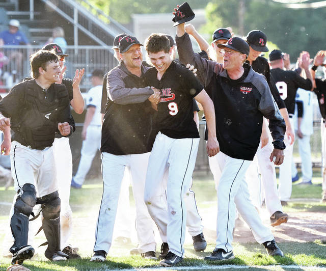 Fort Loramie's Mason Kemper gets a heroes welcome from his coach Jeff Sanders after finishing off Cincinnati Christian during a Division IV regional final on Friday at Carleton Davidson Stadium in Springfield. The Redskins will face Garfield Heights Trinity in a state semifinal on Thursday.