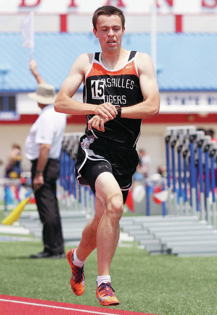Versailles' Joe Spitzer competes in the 1,600-meter run during the Division II regional meet on Saturday at Alexander Stadium in Piqua. Spitzer has the fastest time in the 3,200-meter run and second fastest time in the 1,600-meter run.