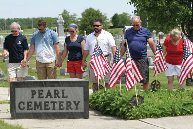 Prayer during Pearl Cemetery Memorial Day ceremony.