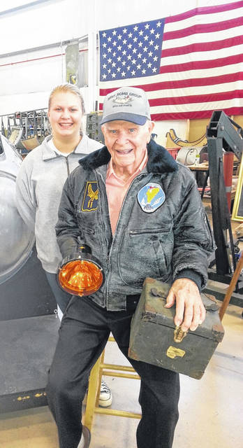 """Jocellen Detwiler, 14, of Urbana, and former Sidney resident Staff Sergeant Arthur """"Art"""" L. Kemp became friends when Jocellen began volunteering at the Champaign Aviation Museum, where she helped with the B-17 restoration project."""