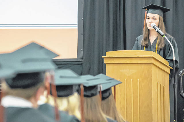 Minster High School Class of 2018 salutatorian Maya Watercutter addresses her fellow classmates during Sunday's graduation ceremony at Minster Elementary School.