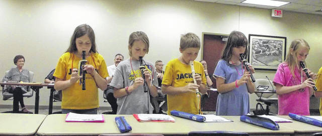 Northwood Elementary School fourth-grade students, left to right, Taylor VanGordon, Nevaeh Owen, Ben Luthman, Lauren Westgerdes and Kylie Harrod play their recorders during Monday night's Sidney City Schools Board of Education meeting.