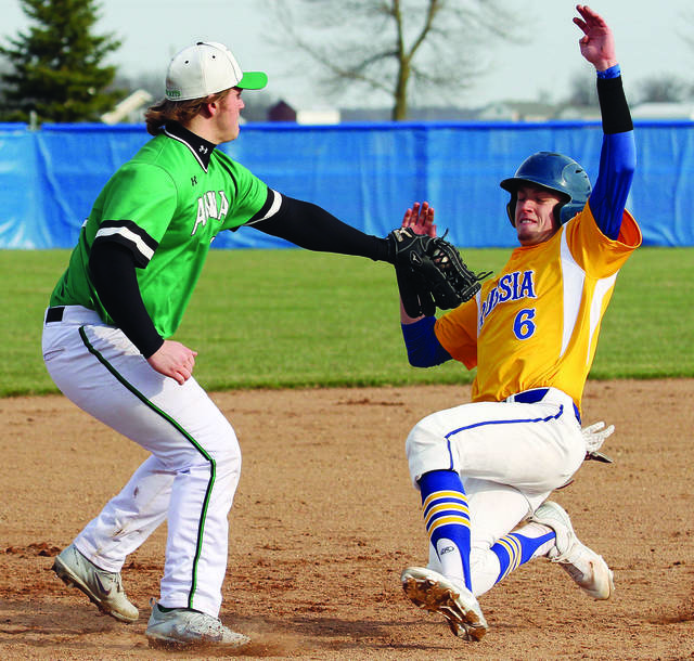 Russia senior Hunter Cohee slides into third base during an SCAL game against Anna in April. Cohee was named the SCAL player of the year for the second consecutive year.