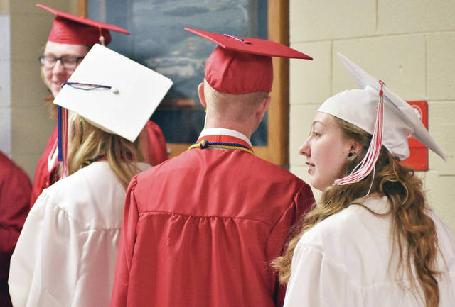 Houston High School seniors wait in the hallway before the start of the Houston High School 89th annual graduation commencement Sunday, May 20.