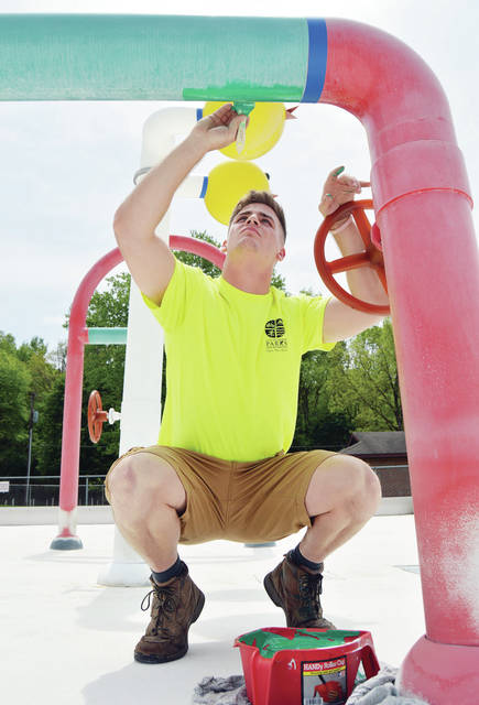 City of Sidney Parks and Recreation employee Damien Duff, of Sidney, gives a new coat of paint to a water pipe in the kiddie pool Thursday, May 17 at the Sidney Municipal Pool. The pool will be opening Saturday, June 2 from 1 p.m. - 7 p.m.. The pool will be open Friday and Saturday 1 p.m. - 7 p.m., Sunday 1 p.m. - 6:30 p.m. and Monday - Thursday 1:30 p.m. - 7:30 p.m..